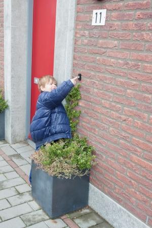 Little boy ringing door bell