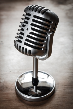 Silver retro look microphone on a grunge table top