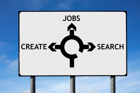 Road sign with roundabout directions pointing towards jobs search and create to illustrate the unemployment in the world photo