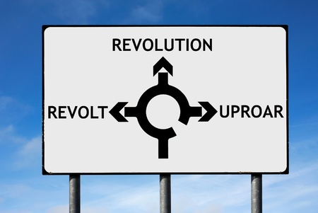 arab spring: Road sign with roundabout directions pointing towards revolution revolt and uproar Stock Photo