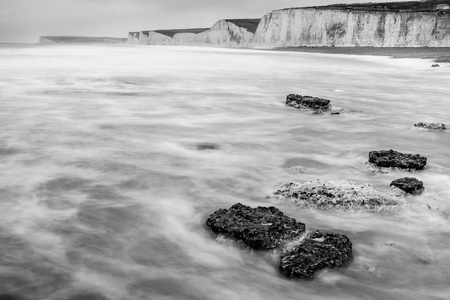 Seven Sisters chalk cliffs and foreground rocks in the English Channel Stock Photo - 19352275