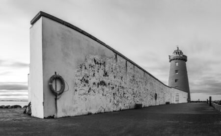 Monochrome panorama of Poolbeg Lighthouse with surrounding wall photo