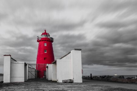 Selective colored red lighthouse in Dublin bay Stock Photo