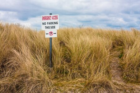 no parking: No parking sign on a dune Stock Photo