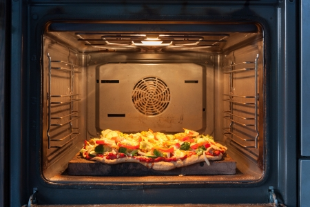 self made: Cooking pizza in hot air oven