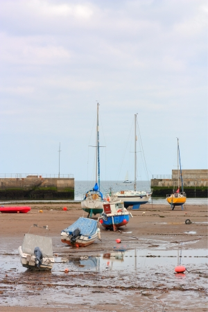 keel: Several boats at low tide resting on their keel