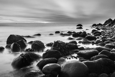 water's edge: Bray Head and the Irish Sea in black and white long exposure image