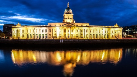 local government: Dublin Custom House at night with reflection in the river Liffey