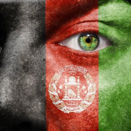 afghan flag: Afghan flag painted on a mans face with a green eye to show San Francisco support Stock Photo