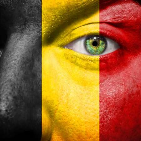 belgium flag: Belgian flag painted on a mans face to support his country Belgium