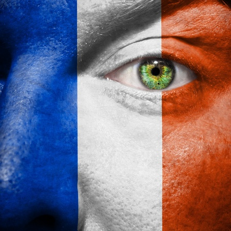 French flag painted on a mans face to support his country France photo