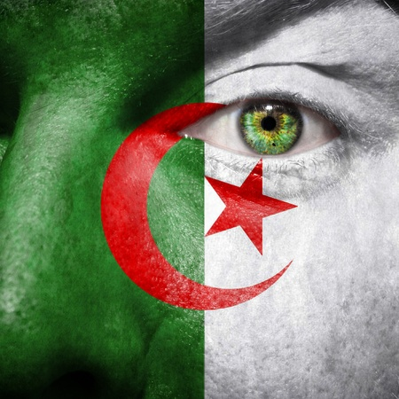 algerian flag: Algerian flag painted on a mans face to support his country Algeria
