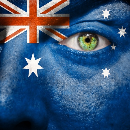 Australian flag painted on a mans face to support his country Australia