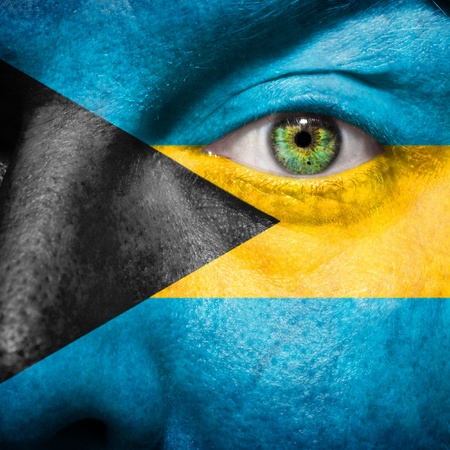 bahamian: Bahamian flag painted on a mans face to support his country Bahamas Stock Photo