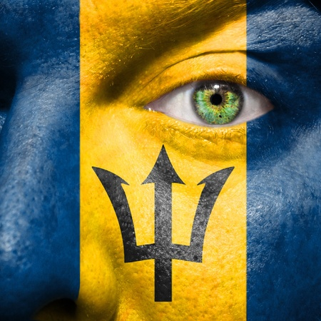 barbadian: Barbadian flag painted on a mans face to support his country Barbados