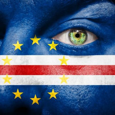 cape verde flag: Cape Verdean flag painted on a mans face Stock Photo