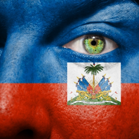 Haitian flag painted on a mans face photo