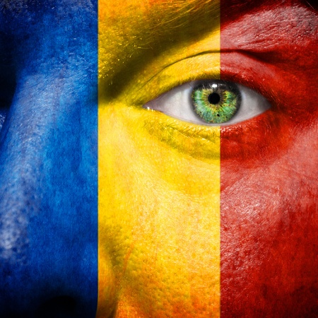 Romanian flag painted on a mans face