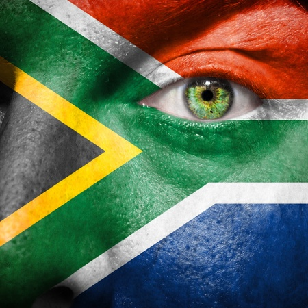 south african flag: South African flag painted on a mans face