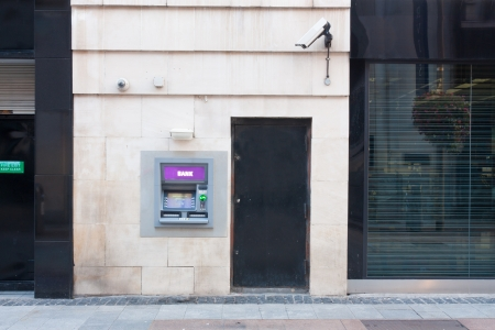 ATM built into a wall in a shopping area photo
