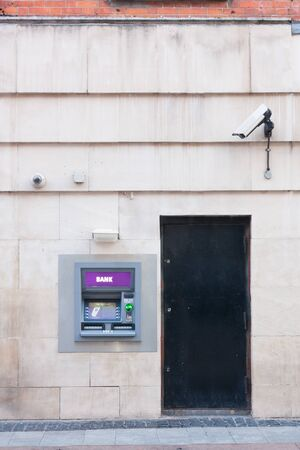 automated teller: Automated Teller Machine outside in a wall Stock Photo