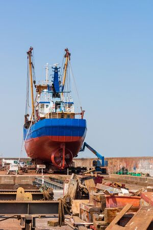 Fishing trawler in a shipyard photo
