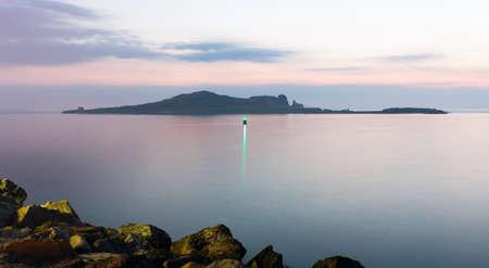 Irelands Eye at dawn long exposure image Stock Photo