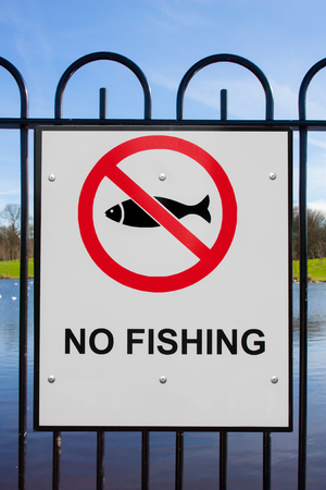 No fishing sign with pond  photo