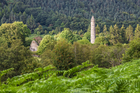 monastic site: Round Tower at the Monastic site in Glendalough Stock Photo