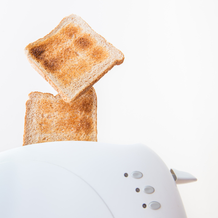 Toasted bread or toast ejected from the toaster when done photo