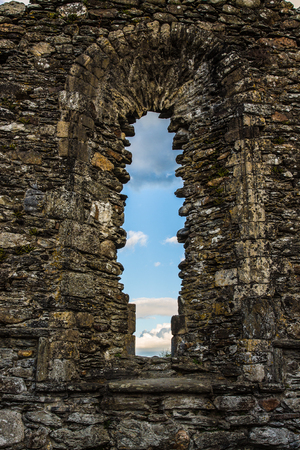 monastic sites: Window detail of The Cathedral in the Monastic City located in Glendalough Ireland Stock Photo