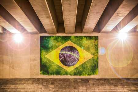 Brazilian flag painted on a wall of an overpass photo