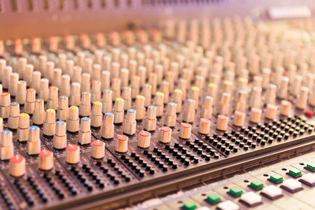 Close up of a studio mixing table with selective focus photo