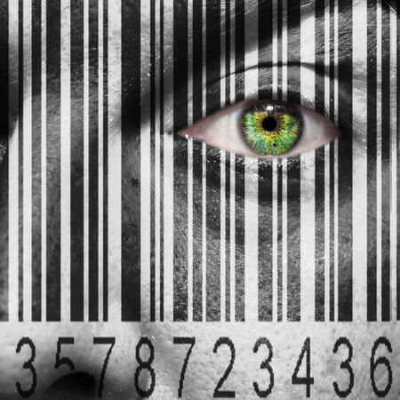 manipulating: Barcode superimposed on a mans face to suggest the concept of slavery or human trafficking