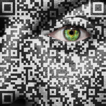 QR Code superimposed on a mans face to suggest the concept of slavery or human trafficking