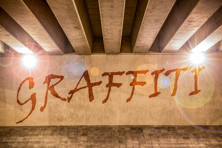 Graffiti painted as graffiti on the support column of an overpass Stock Photo - 24997692