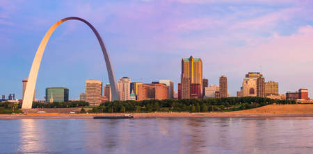 St Louis Arch and skyline at the Mississippi river at sunrise seen from East St  Louis