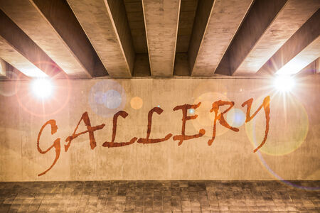 The word gallery painted as graffiti on the support column of an overpass Stock Photo - 24998032