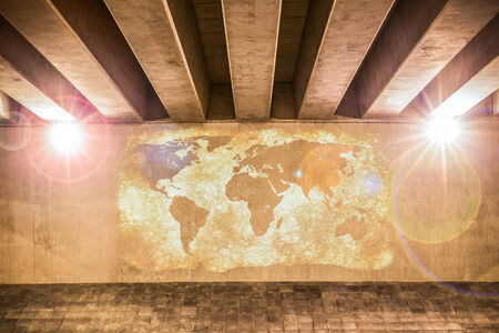World map painted on a wall of an overpass photo