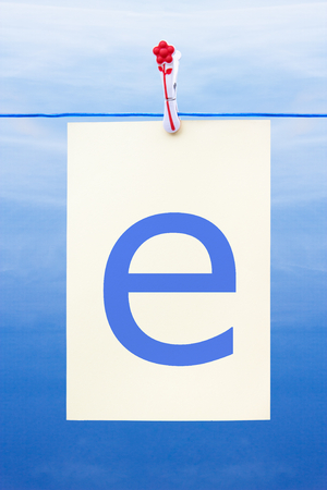 Seamless washing line with paper against a blue sky showing the letter e