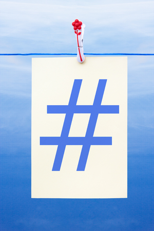 Seamless washing line with paper against a blue sky showing hashtag photo