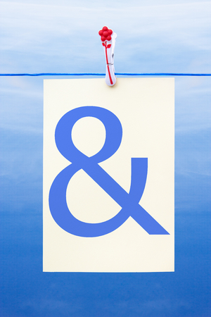 Seamless washing line with paper against a blue sky showing ampersand photo