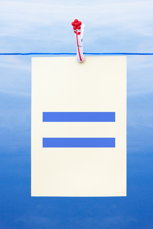 sign equals: Seamless washing line with paper against a blue sky showing equals Stock Photo