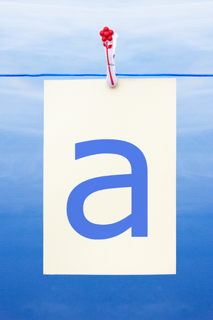 Seamless washing line with paper against a blue sky showing the letter a