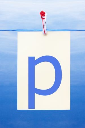 letter p: Seamless washing line with paper against a blue sky showing the letter p Stock Photo