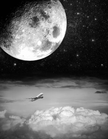Big moon and airplane above the clouds photo