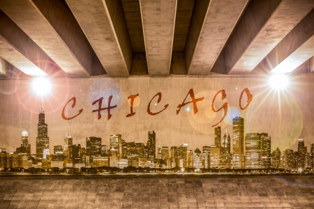 Chicago graffiti text and skyline on the support column of an overpass photo
