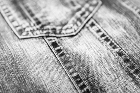 Close up of a denim jacket with shallow depth of field in black and white photo