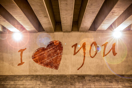 i beam: I love you with heart painted as graffiti on the support column of an overpass