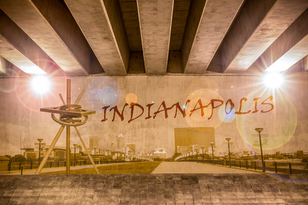 Indianapolis graffiti text and skyline on the support column of an overpass photo